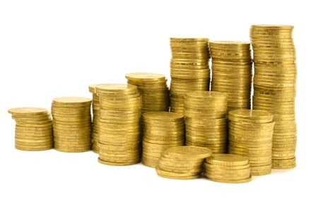 stacks of yellow coins isolated