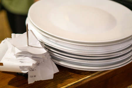 clean plates stand on a wooden bar near the checks / copy space