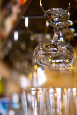 glasses hanging over the bar on a blurred background glasses and glasses. copy space