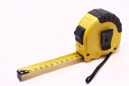 Tape-line isolated on white background. Tape measure for construction work. Imagens