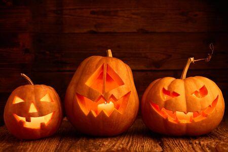 Halloween - old jack-o-lantern on wooden background