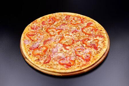 Pizza Margherita on darken background in an italian restaurant.