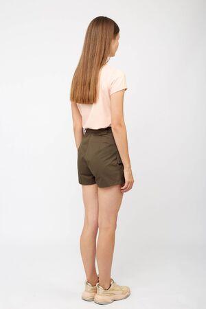 Teenager girl in khaki cargo shorts 版權商用圖片