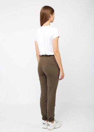 girl in khaki sweatpants and a t-shirt Reklamní fotografie