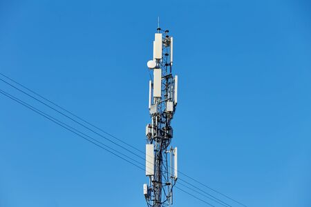 Technology on the top of the telecommunication GSM (5G,4G,3G) tower.Cellular phone antennas on a building roof.Telecommunication mast television antennas.Receiving and transmitting stations Stockfoto