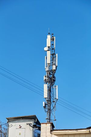 Technology on the top of the telecommunication GSM (5G,4G,3G) tower.Cellular phone antennas on a building roof.Telecommunication mast television antennas.Receiving and transmitting stations Фото со стока