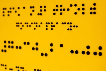 Close up of braille Code. Yellow abstract backgrounds and textures Reklamní fotografie