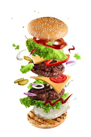 Maxi hamburger, double cheeseburger with flying ingredients isolated on white background. High resolution image Foto de archivo - 138181164