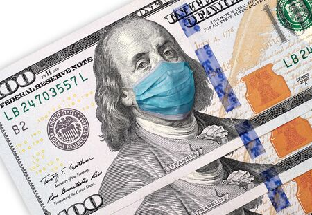 COVID-19 coronavirus in USA, 100 dollar money bill with face mask. Crisis and finance concept. Isolated on white background. Stock Photo