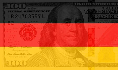 colorful waving german flag on a american dollar money background Reklamní fotografie