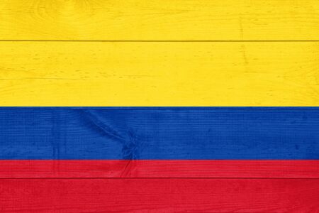 Flag of Colombia painted on grungy wood plank background