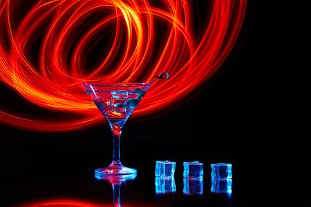 Neon martini glass shot with long exposure. Red club lights.