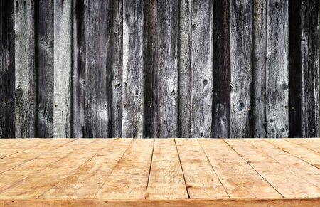 Empty yellow sandy wooden table background Imagens