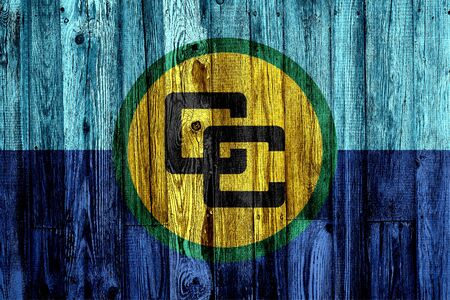 Caricom flag on wooden background