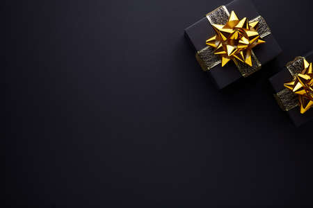 Merry Christmas and Happy Holidays greeting card, frame, banner. Black background. Stock Photo