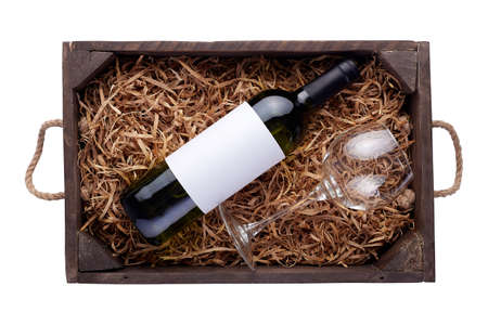 Red wine bottles packed in open wooden box isolated on white background Stock Photo