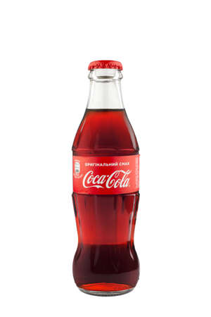 Kyiv, Ukraine- March 20, 2021: Coca-Cola Classic in a glass bottle Isolated on white Background.