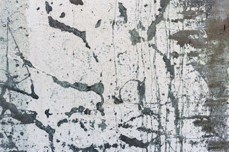 Closeup fragment of grunge weathered wall of a building