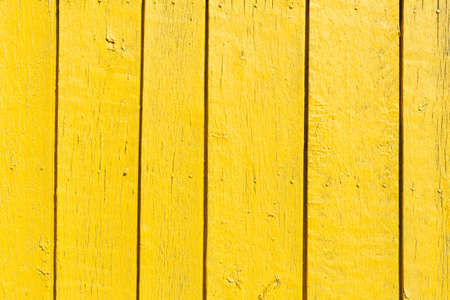 Seamless empty space background of vintage textured yellow wooden wall with rough weathered surface