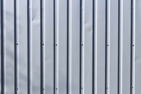 Vertical corrugated metal sheet wallcan used for backgrond