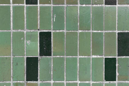 Old green tiles on the wall used for background