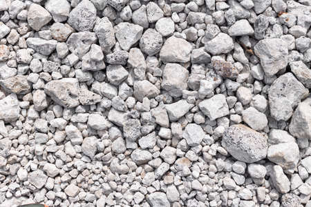 Gray ground stone rubble background of many small stones
