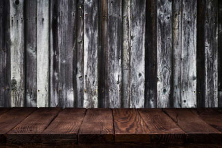 Scene creator. Mockup. Empty wooden deck table with dark wooden wall background.