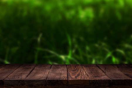 Scene creator. Mockup. Empty wooden deck table with summer bokeh background.
