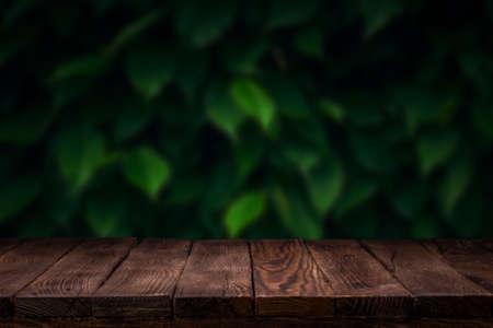Scene creator. Mockup. Empty wooden deck table with summer bokeh background. 版權商用圖片