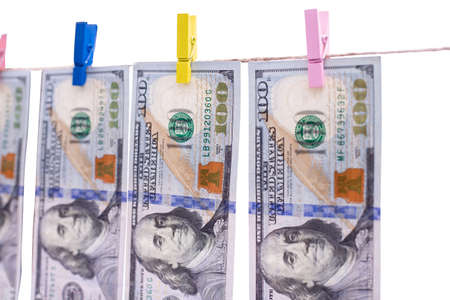 Concept - money laundering. Dollars are dried on the ropes. Dollars after washing. Money earned honestly 版權商用圖片