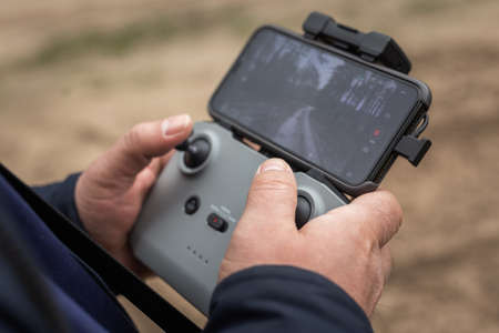 Hands in remote controller for drive a drone.