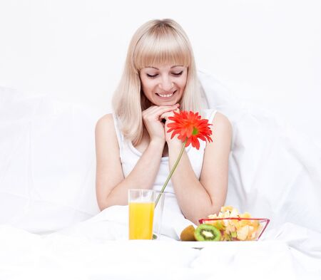 Cute girl has a breakfast in the bed