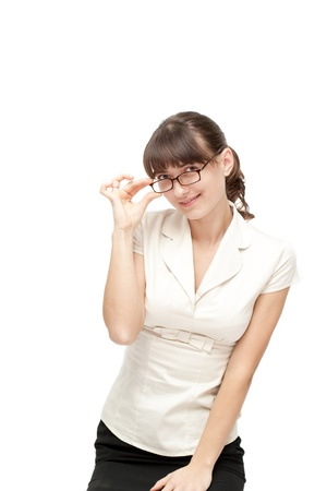 Happy businesswoman in glasses posing isolated on white
