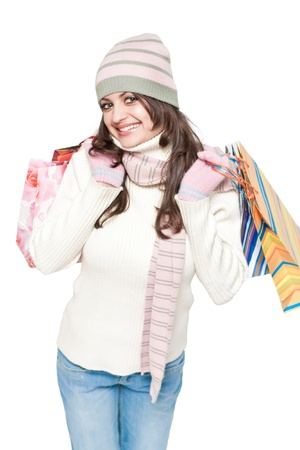 Dressed young beautiful woman with colorful shopping bags