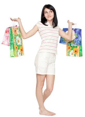 Young beautiful woman with colorful shopping bags