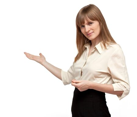 Good looking business woman is pointing on isolated background