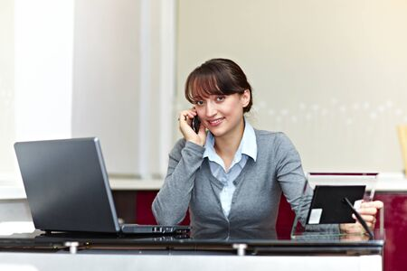 Cute business woman with phone Stock Photo