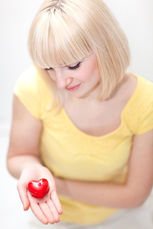 Beautiful lady holding heart Stock Photo
