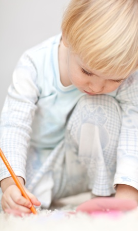 Nice little boy writting something Stock Photo
