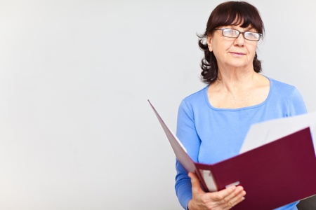 Nice senior woman with folder Stock Photo