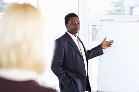 African American male speaker giving a presentation at business meeting Stock Photo - 9067853