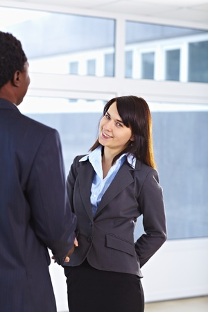 African American business man and caucasian woman handshake at office building Stock Photo - 9067857