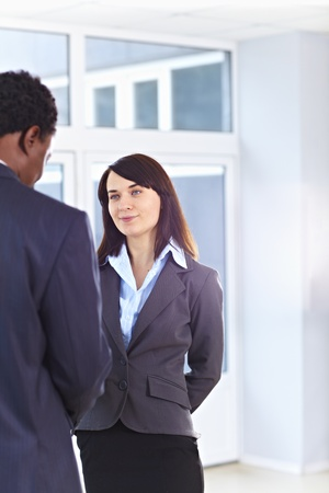 African American business man and caucasian woman handshake at office building Stock Photo