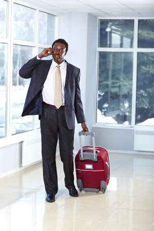 African American business man walking with travel bag Stock Photo