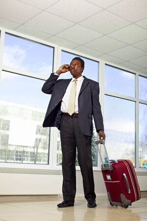 African American business man walking with travel bag Stock Photo - 9067867