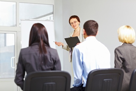 Good looking teacher with her students at seminar Stock Photo