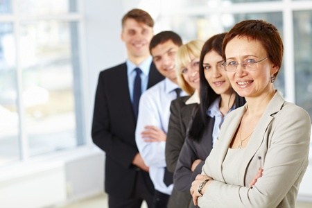 Beautiful business woman and her business team Stock Photo - 9071831