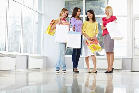 Happy young adults with shopping bags photo