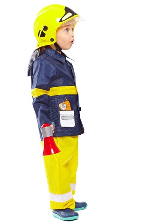 Little boy in fireman costume with megaphone isolated on white
