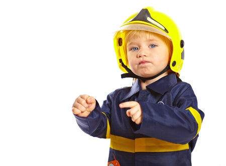 Little boy in fireman costume and helmet isolated on white